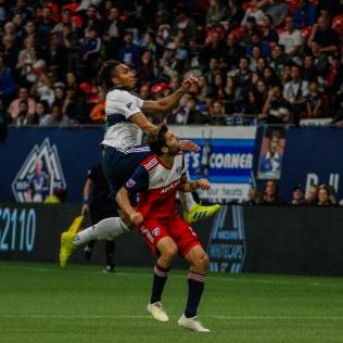 Theo Bair leaping above FC Dallas' Ryan Hollingshead