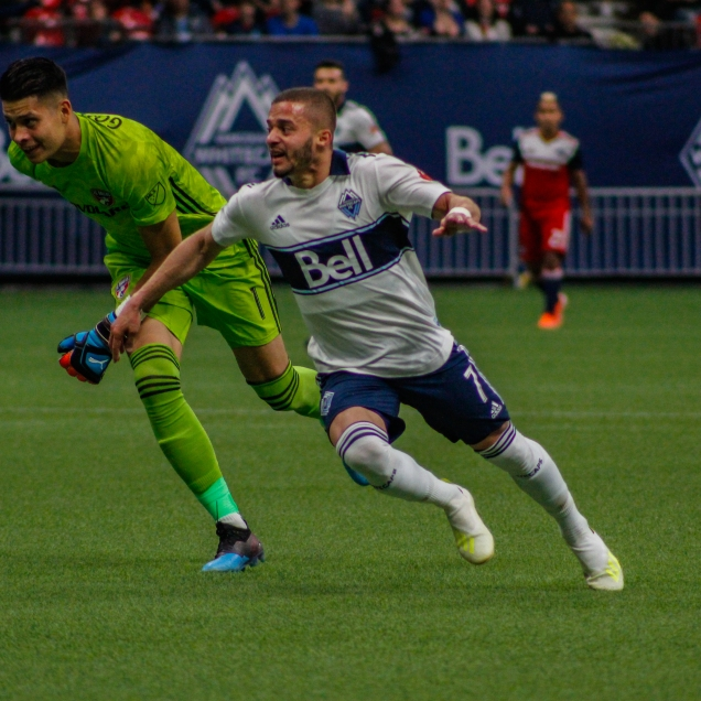 Lucas Venuto rounding FC Dallas' Jesse Gonzalez in the final minutes of the the game